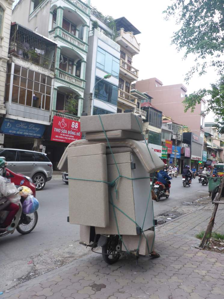 Transporting a sofa on the back of a scooter